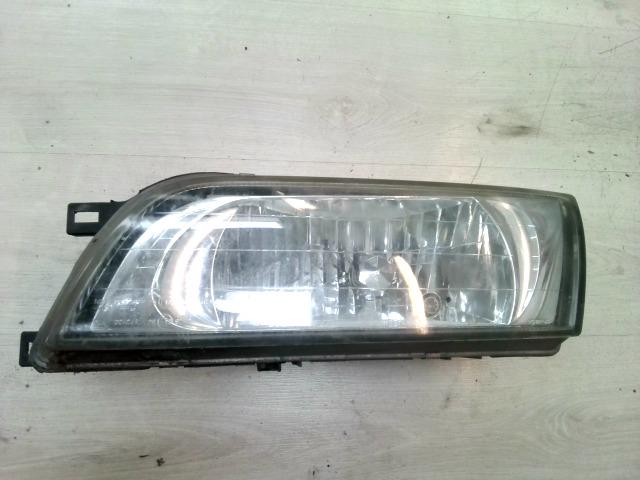 NISSAN ALMERA 96-98 Bal fényszóró motoros állítású bontott alkatrész