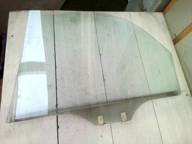MAZDA 121 90.12.01-96.02.28 Jobb hátsó ajtóüveg bontott alkatrész